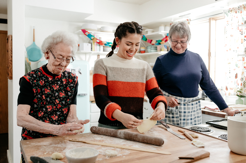Host Molly Yeh, with her aunts making Potato Flatbread.jpeg