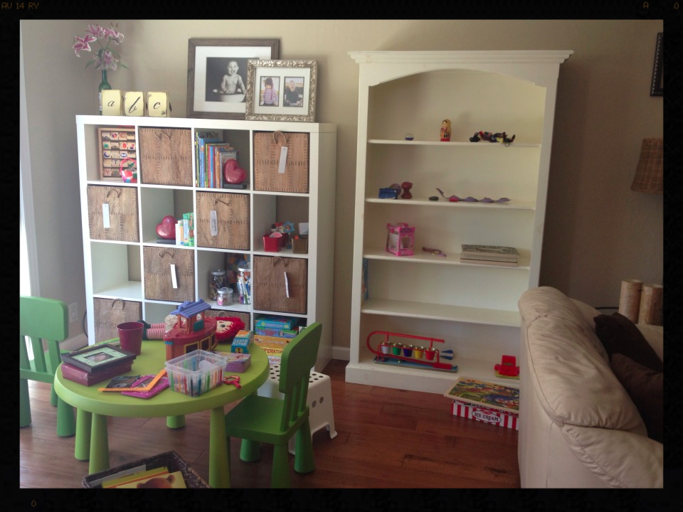Before picture of a kids area and family room.