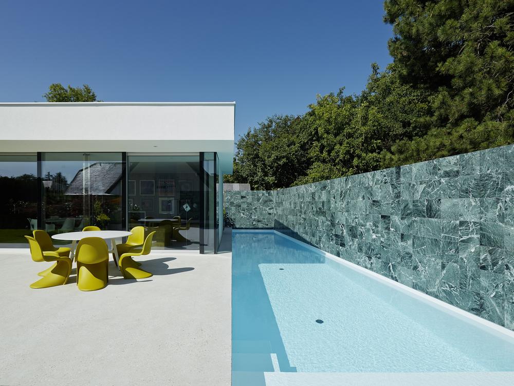 522cf203e8e44e9ea00000bd_house-a-b-smertnik-kraut-architekten_portada_-1-.jpg