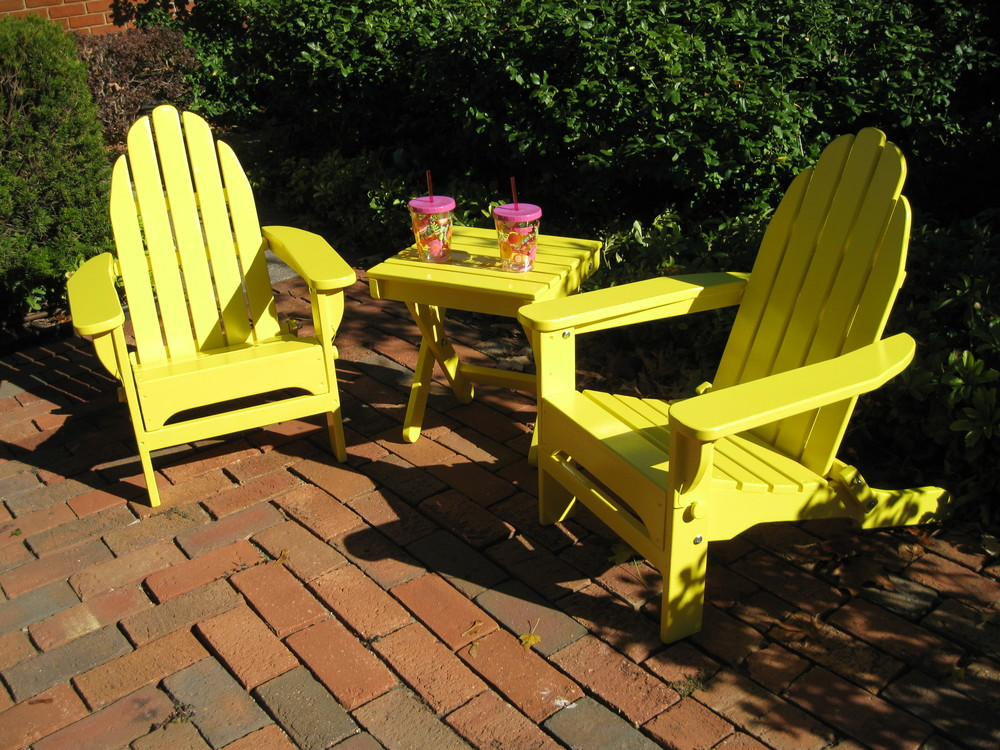 Child - size folding Adirondack chairs with matching table. Locally designed and handcrafted. SOLD Value: $200 Starting Bid: $120