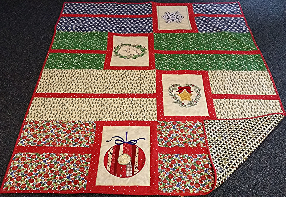 "Handmade 64""x 52"" block Christmas quilt    Value: $100    Starting Bid: $60"