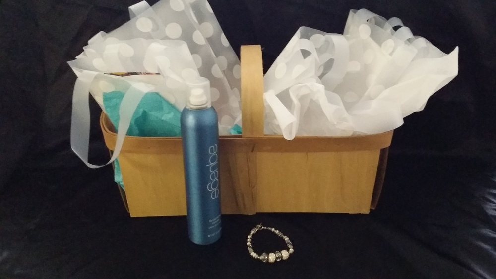 Jackie's Beauty Place & Boutique Gift Basket includes: Highlight/Haircut/Style, Hairspray, Spa Pedicure and Bracelet Value: $127 Starting Bid: $75