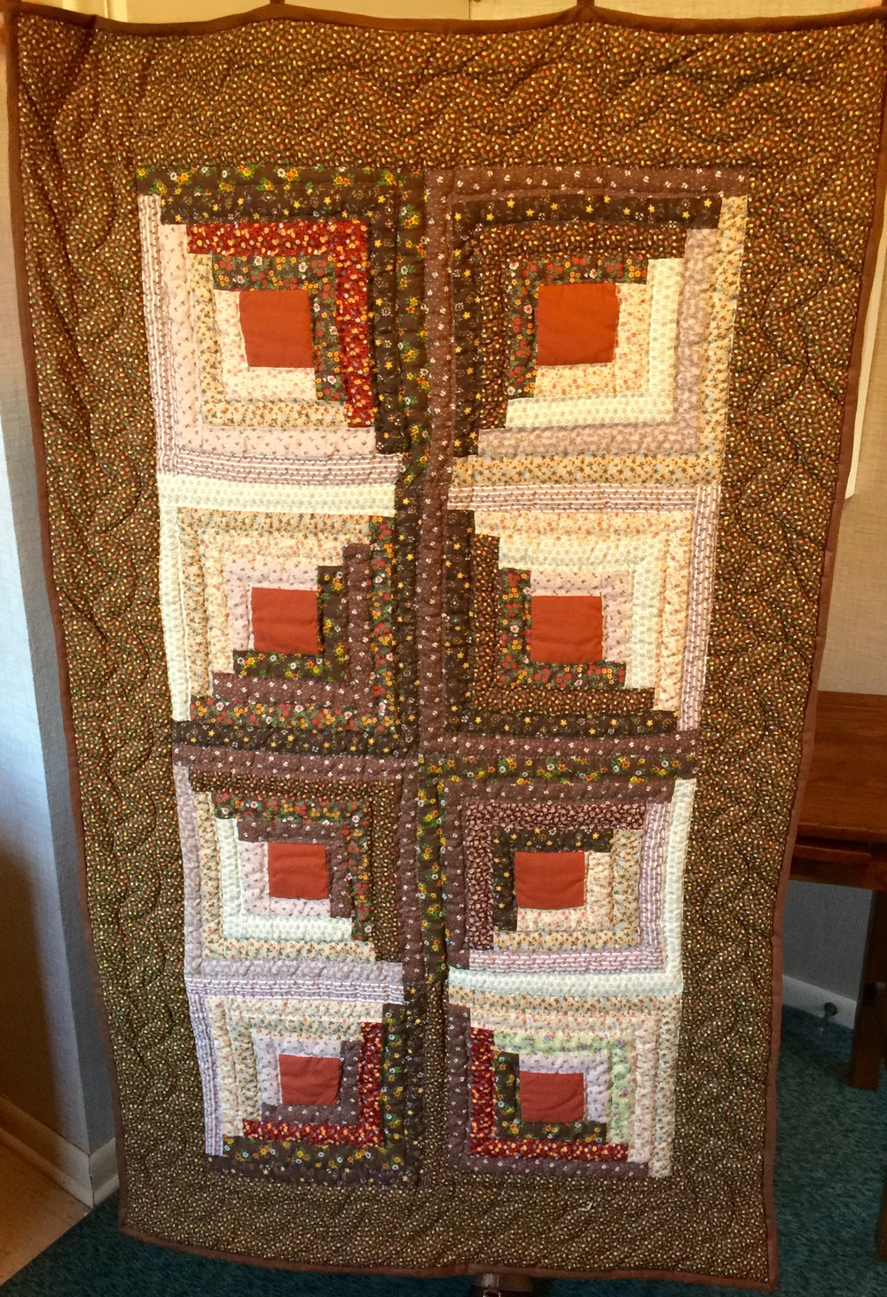 Hand Quilted Log Cabin Wall Hanging       Value: $150    Starting Bid: $90