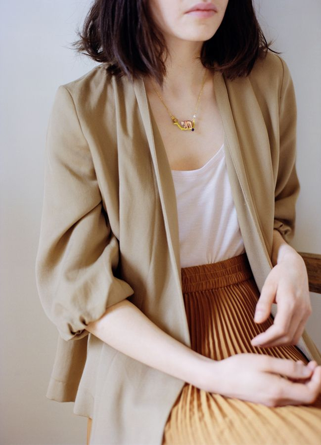 Pair a 1970s pleated skirt with a modern blazer and loose white tee for an instant update.
