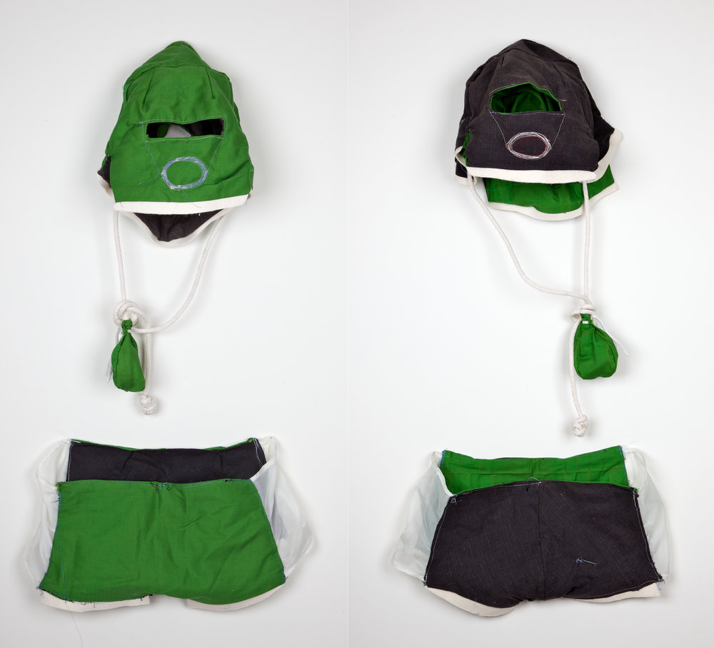Knickers and mask. Reversible (from green to black). Small bag hanging from mask has extra cord. Size XS.  This cloth got pulled off a derelict sofa, before it got set in the street, found in extended family's apartment back room. Clear nylon panels on knicker sides leftover from a 2001 installation.