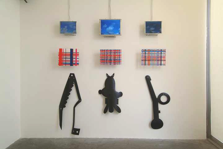 "2004. Clouds, Plaids, Forms. Time lapse clouds, layered plexi plaids, 1/4"" rubber forms."