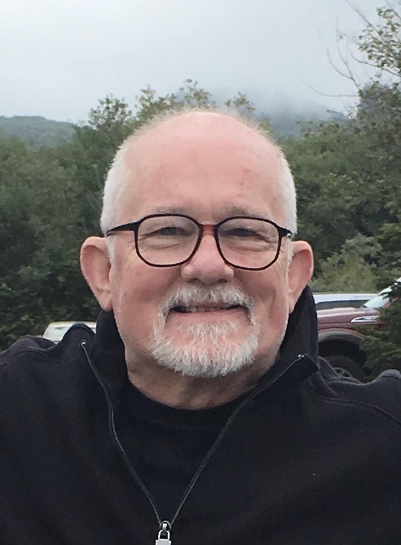 Doug's headshot five in front of trees.jpg