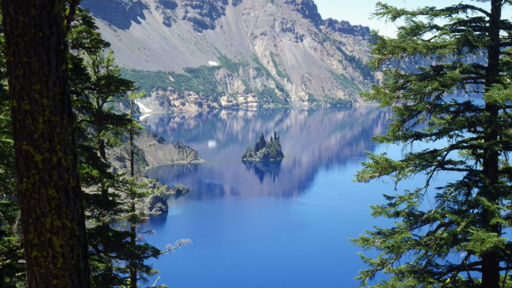 Phantom Ship with Garfield Peak reflecting off the water of Crater Lake.