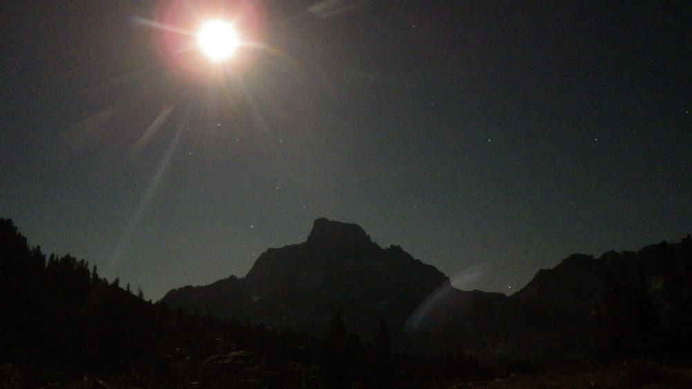 The moon shining bright over Banner Peak