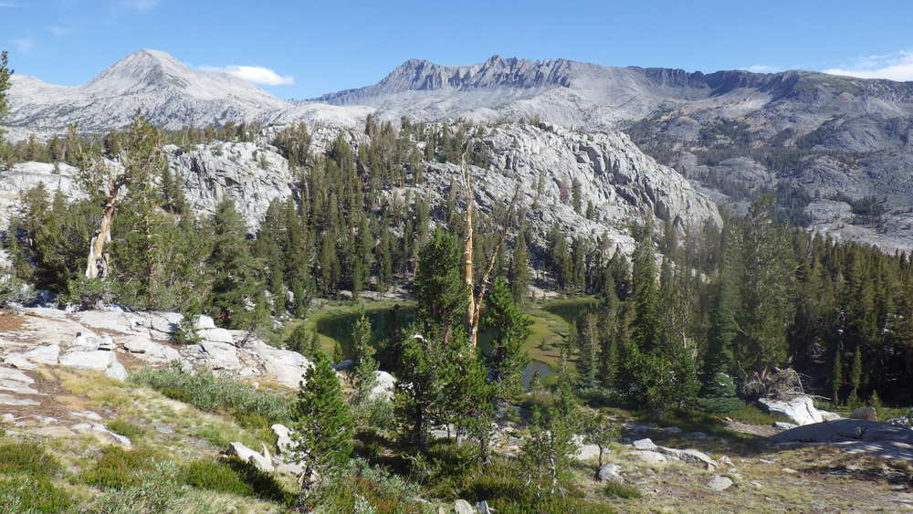 Overlooking a small tarn and granite peaks from the trail near Island Pass