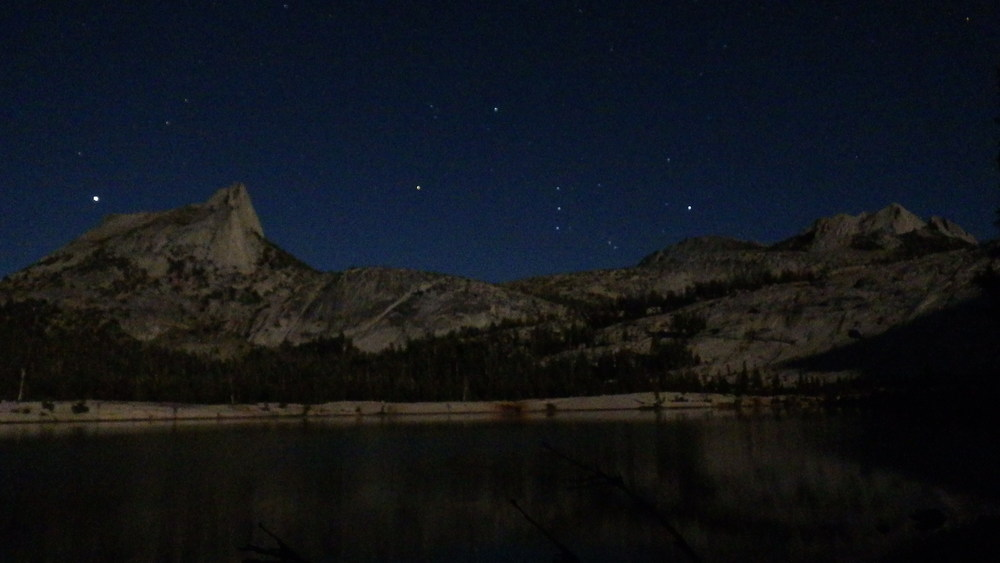 Cathedral Peak and Echo Peaks over Lower Cathedral Lake lit up by a full moon on night four