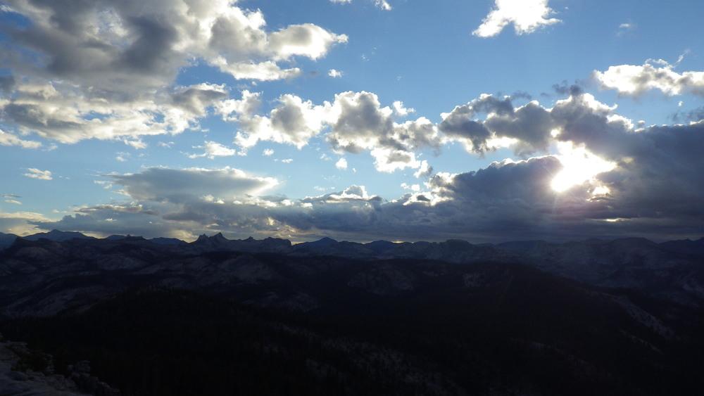 The rising sun peeking through the departing storm clouds