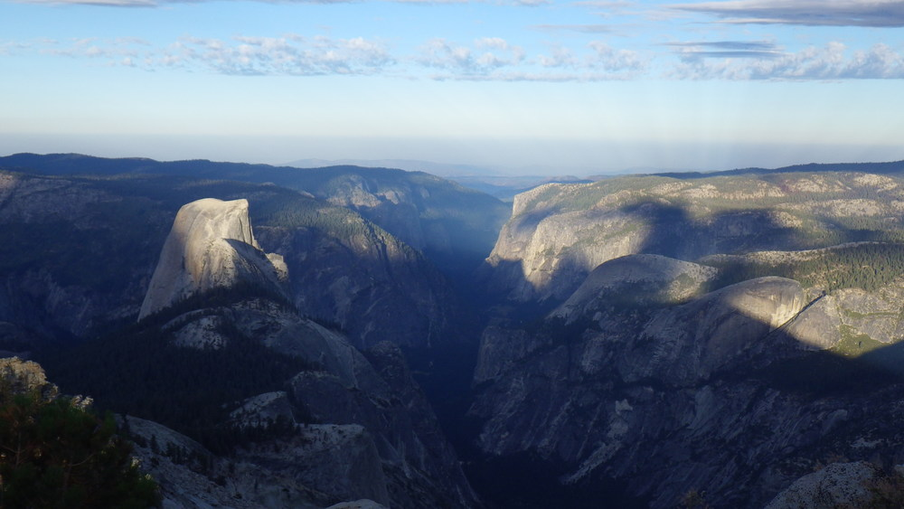Half Dome and Yosemite Valley shining under the days first light