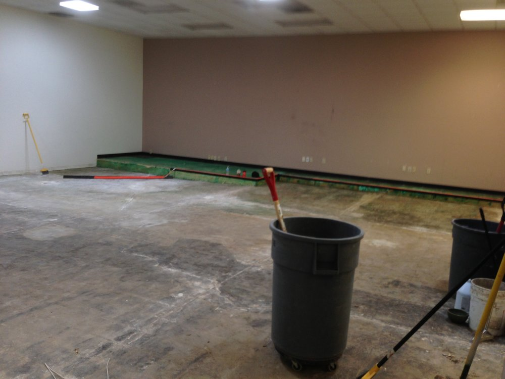 Before: This floor required self leveling and heavy grinding to remove debris and adhesives.