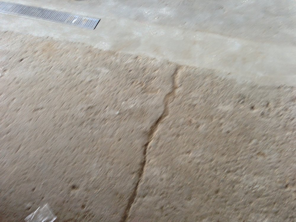 Before: This concrete floor was in extremely poor condition after years of hard use.