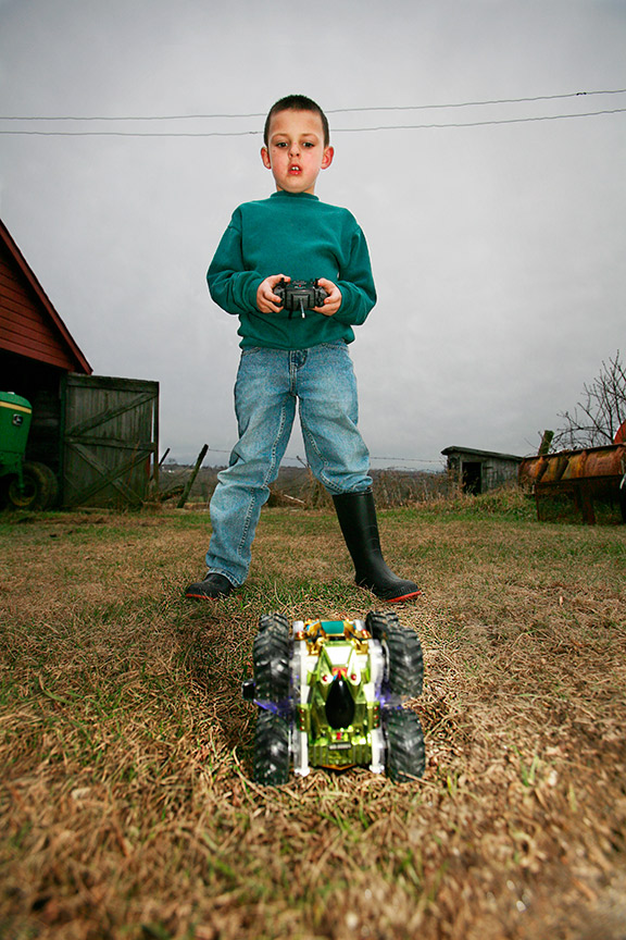 Farm_Boy_With_Toy.jpg