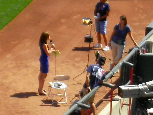 MLB Sportscaster Sam Ryan in action at theReds vs. Cardinals game 2012.