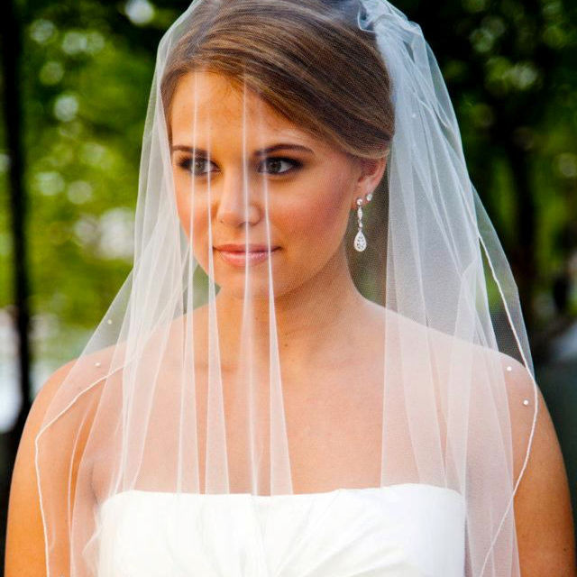 Bridal makeup with veil by Chenese Bean