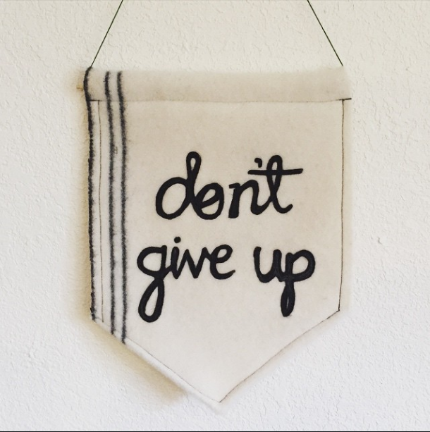 don't give up banner