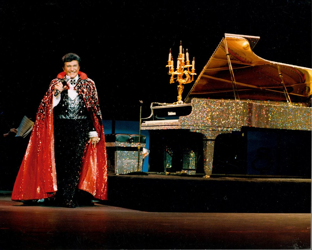 LIBERACE ON_STAGE_WITH_RHINESTONE_PIANO-760234.jpg