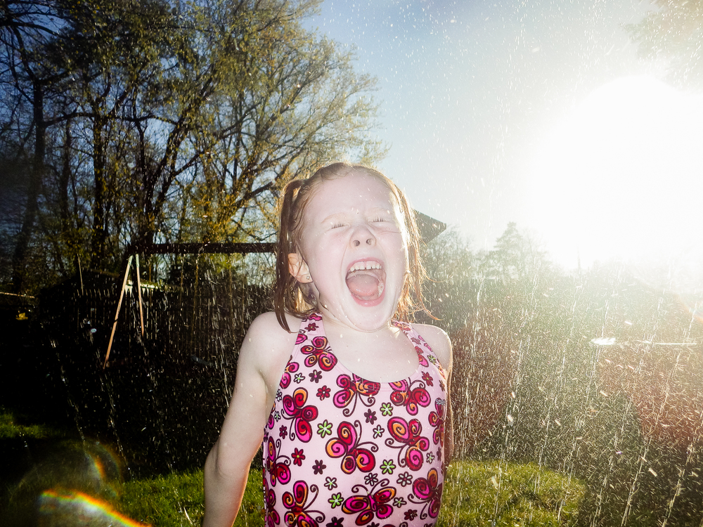 We spent about 30 minutes running through the sprinkler on a day that wasn't nearly as warm as it looks.