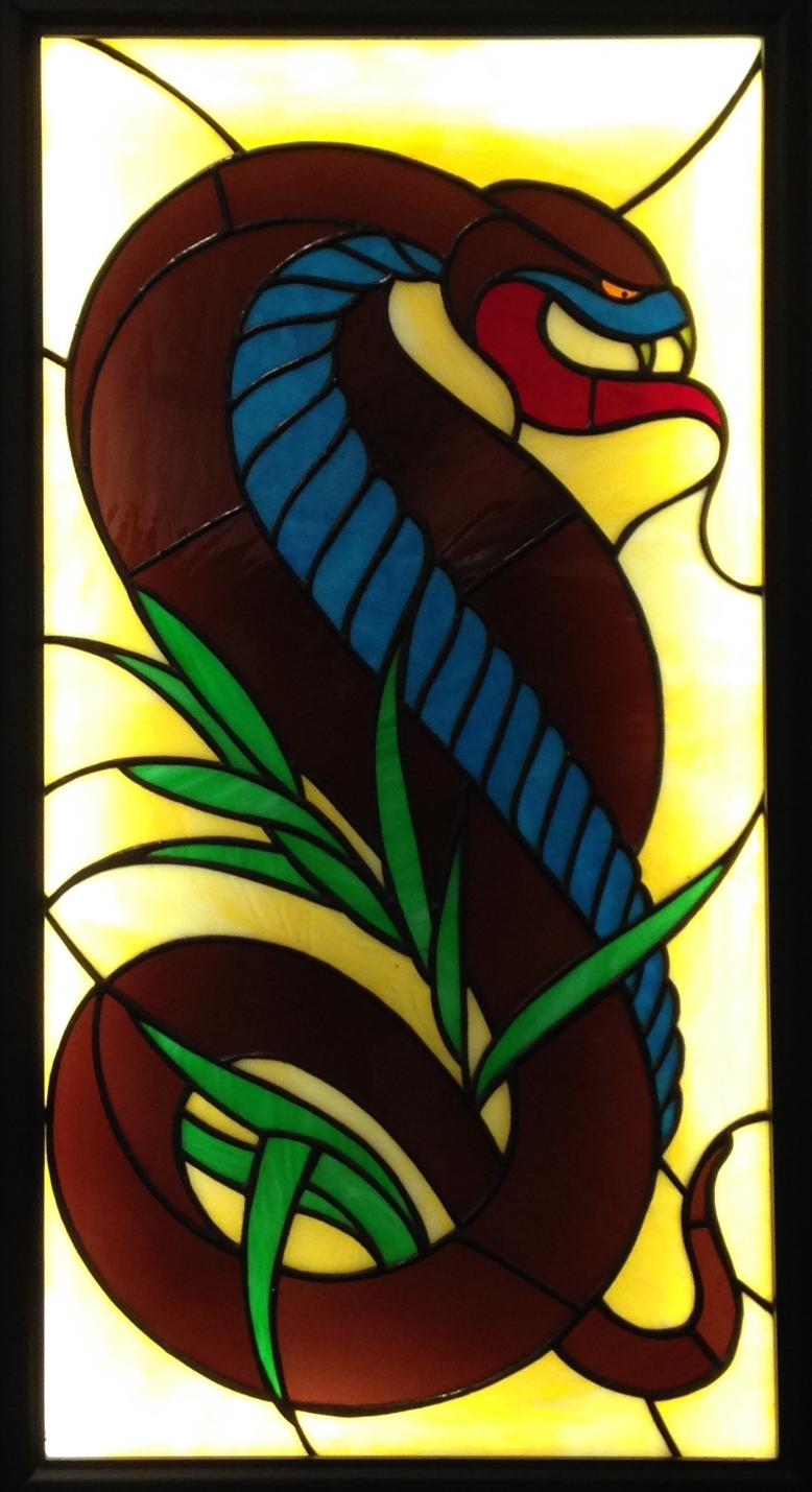 """REX ASPIDIS"" 16""X31"" (SIZE OF GLASS ONLY) Foiled stained glass, kiln fired glass paint, & LED lights $2250"