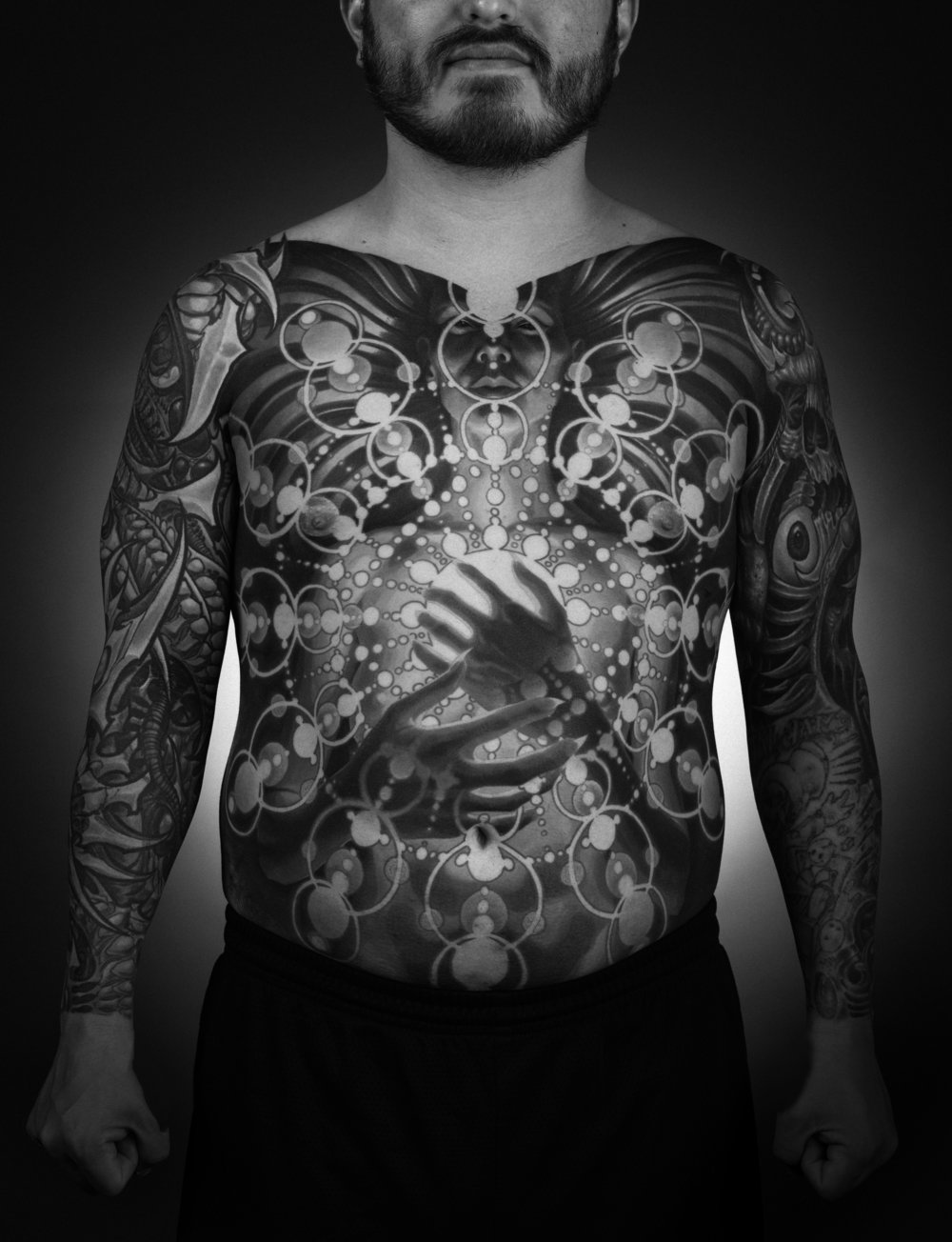 280 PAGES OF LAVISHLY DOCUMENTED TATTOOING - Longtime collaborator Max Dolberg exclusively photographed all the collectors in studio resulting in a uniformly documented body of work.