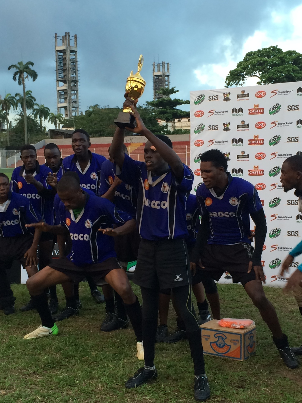 Captain Nuhu Ibrahim holds the Cup aloft.