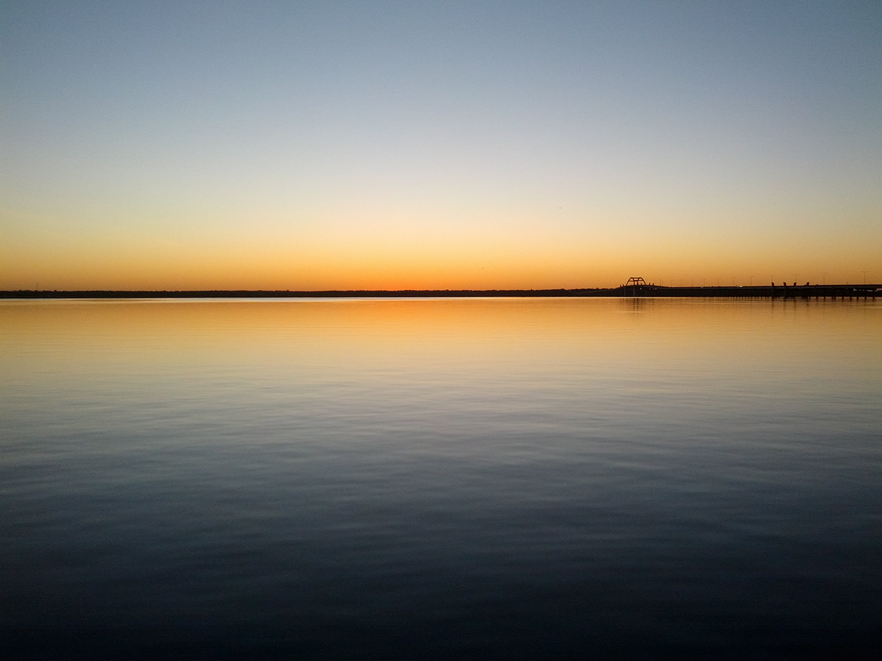 Photo of Sunrise over Lewisville Lake, TX taken by Fr. Anthony Borrow, S.J.