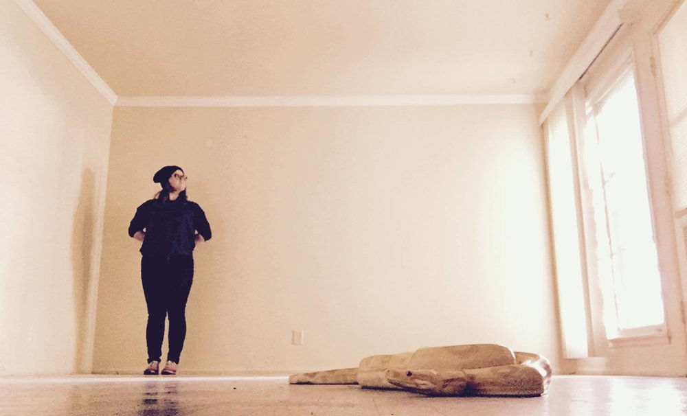 Ruben the snake and I in our empty LA apartment on moving day. Jan 2017
