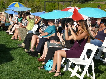 The guests watch intently, shaded with lovely umbrellas courtesy of Zenith Vineyard.