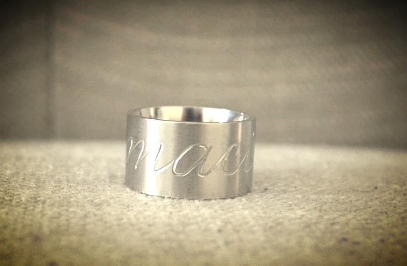 Engraved ring houston calligraphy.jpg