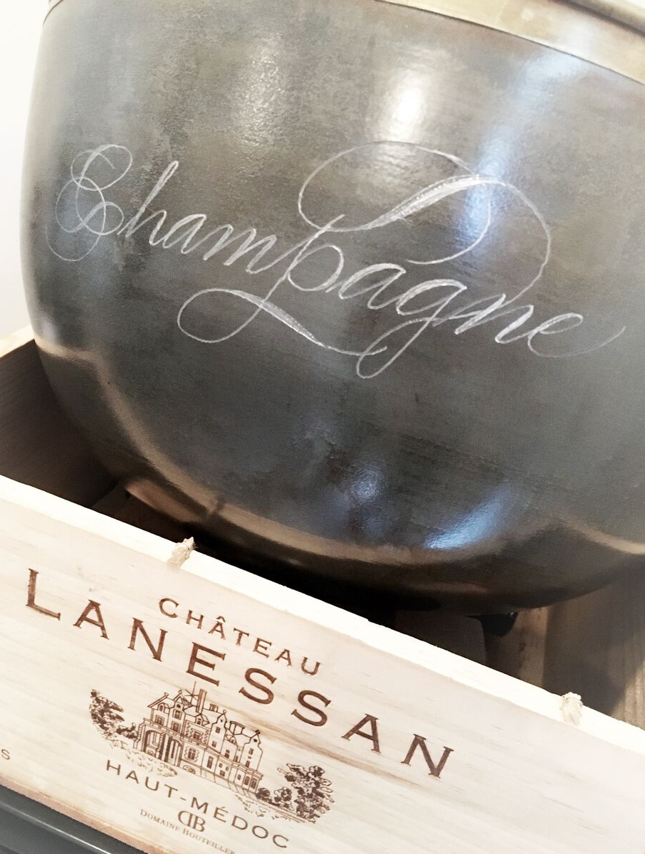 Hand engraved calligraphy in a champagne bucket