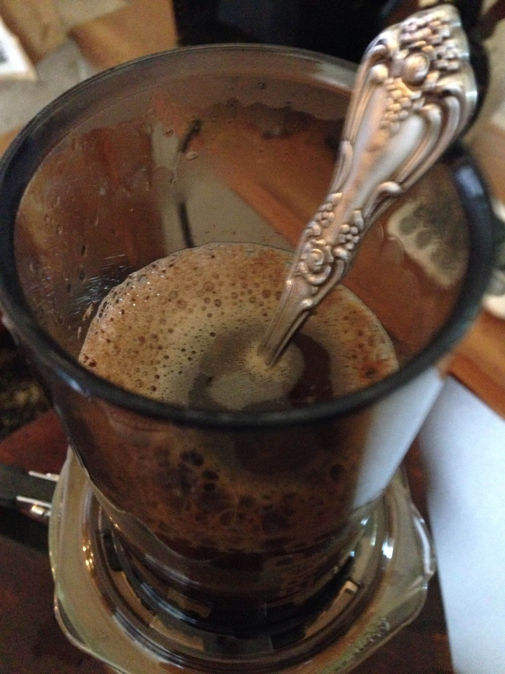 Stir the coffee as needed until all the water is added.