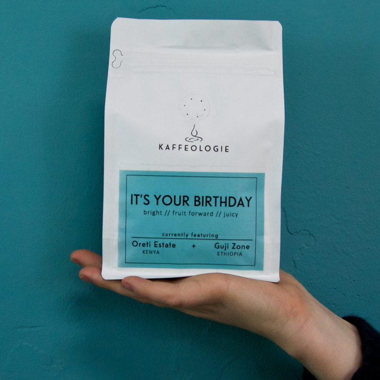 photo of a bag of dear diary coffee held in the palm of your hand