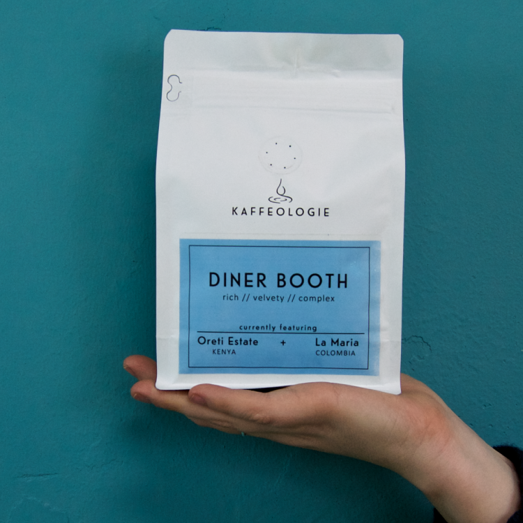 photo of a bag of diner booth coffee held in the palm of your hand