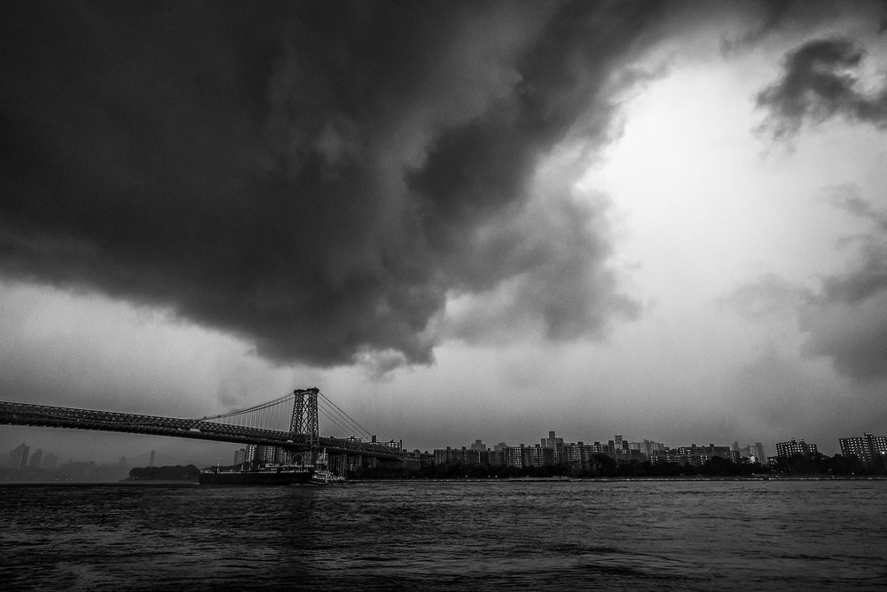 """Storm over Williamsburg"" June 2014, Brooklyn, New York Fujifilm XPro1, 14mm, f/8, 1/40, ISO 1600   In June, I drove to Grand Ferry Park in Williamsburg to photograph an event called the ""World Naked Bike Ride."" It was going to be a bizarrely great photo op. But nature had other plans. Not more than 15 minutes before the official meet-up time for naked bike riding, this storm rolled in. I stayed around just long enough to take a few dramatic shots before the sky opened up, dumping a monsoon of rain across the city. I'll never know if they went ahead with the naked bike ride.   A day after I posted this photo, I got a notification that one of my favorite National Geographic photographers,  Jim Richardson  added it as a favorite on Flickr, which is the photography equivalent of Frank Sinatra stopping by to compliment your karaoke performance."