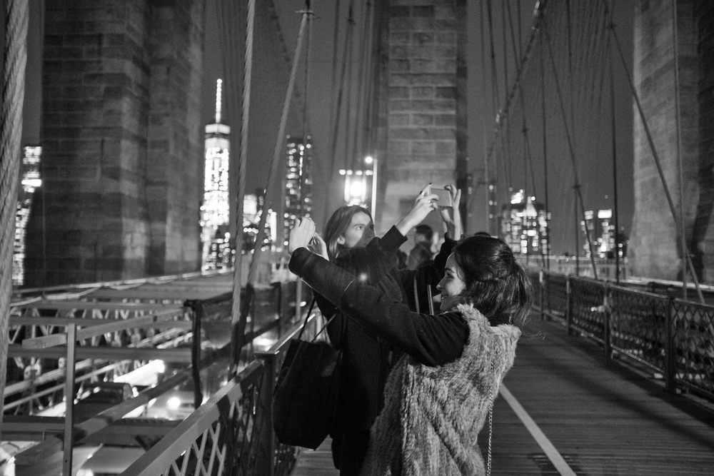 """Synchronized selfies"" December 2015, Brooklyn Bridge, NY Fujifilm X100s, 23mm, f/2, 1/20, ISO 3200"