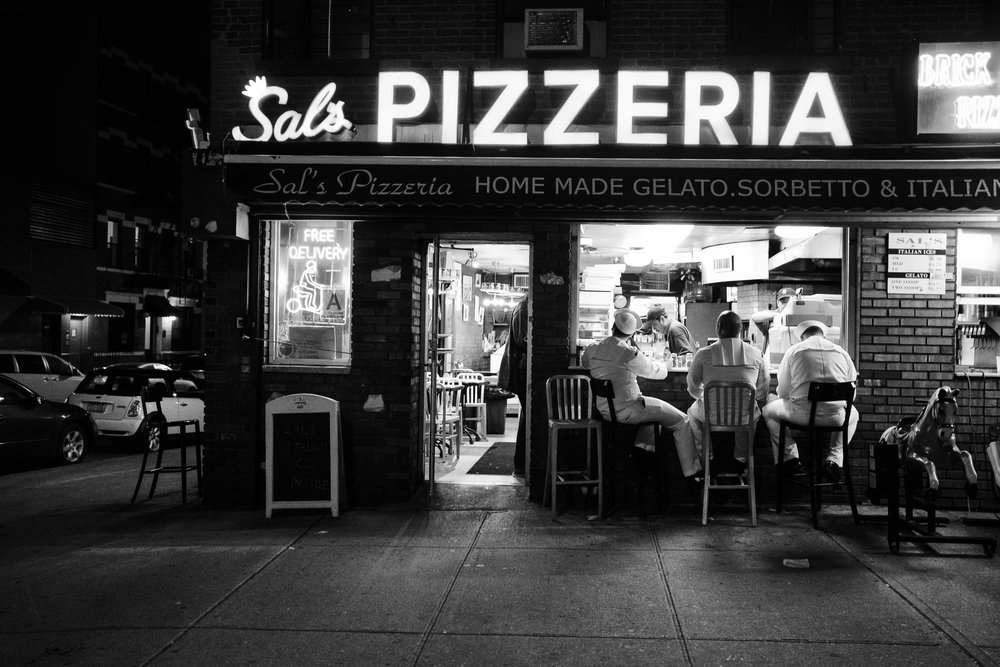 """The Navy and the Pizza."" May 23, 2017. Cobble Hill. Brooklyn, NY. Fujifilm X-Pro2, 23mm, f/2.5, 1/125, ISO 5000"