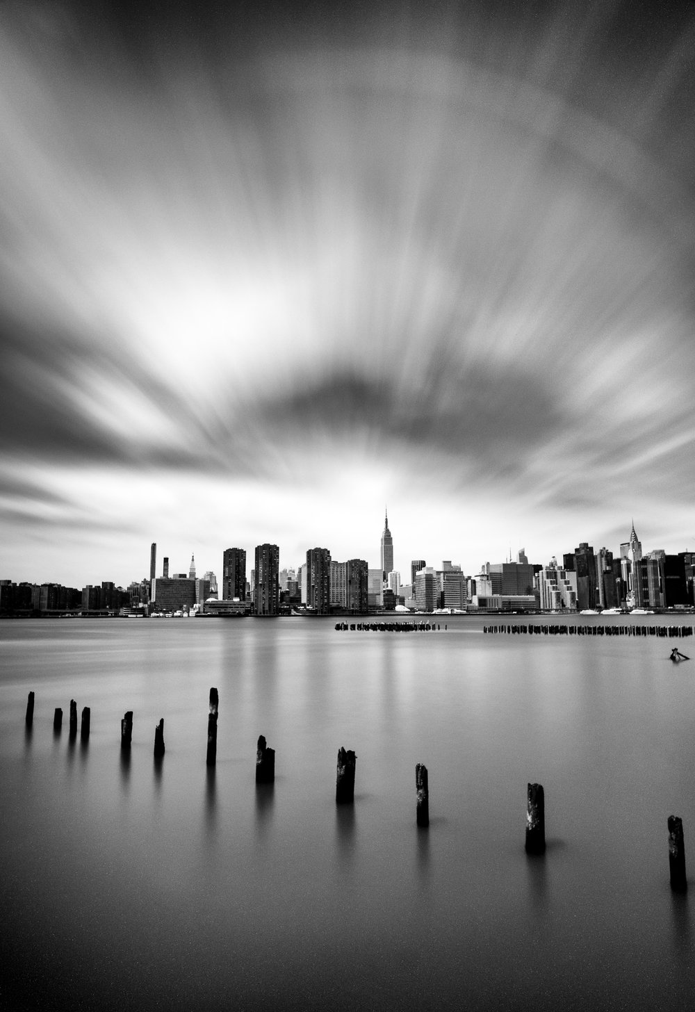 """Live fast"" May 11, 2018. Greenpoint, Brooklyn Fujifilm XPro2, 14mm, f/8, 243 sec, ISO 200   This four minute long exposure was long enough to give the clouds over New York an epic motion blur. The semi-circle at the top of the frame was a happy accident - it's caused by the rim of my lens reflecting back in the ND filter that I added to the front of my camera for the long exposure.  This photo was included in an article in FeatureShoot called  The Magic of Black and White in 27 photos     Thanks for reading! And if you want to see more, you can check out  2017's Year in Review ,  2016's Year in Review ,  2105's Year in Review , or  2014's Year in Review . Or follow me on  Flickr  or  Instagram ."
