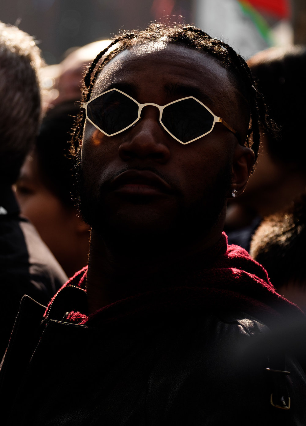 I underexposed this shot to dramatize the way the gold rims of this guy's glasses caught the reflected sunlight.