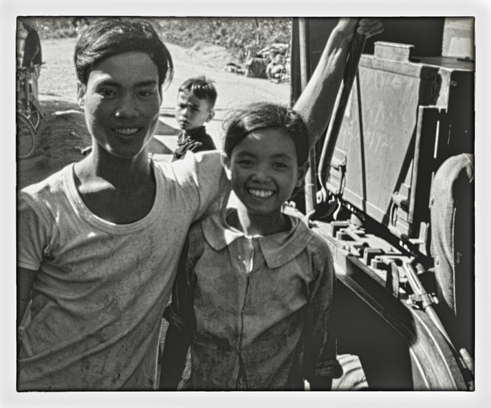 vn24 boy and girl at jeep-2.jpg
