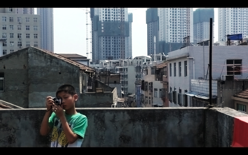 "Out of Focus 2013 | China | Documentary | 88 min | HD | Color |  POSTER   TRAILER   Director: Shengze Zhu   |   Producers: Zhengfan Yang & Shengze Zhu   |   Cinematographer: Zhengfan Yang & Shengze Zhu   |   Sound Mix: Siya Huo   |   Editor: Shengze Zhu & Zhengfan Yang      * Cinéma du Réel International Documentary Film Festival,  International First Films Competition (France, 2014)      * DMZ International Documentary Film Festival, International Competition (South Korea, 2014)      * FRONTEIRA International Documentary & Experimental Film Festival (Brazil, 2014)      * Scarborough Film Festival (Canada, 2014)      * China Independent Film Festival (China, 2014)      * China Women's Film Festival, Grand Jury Prize (China, 2014) SYNOPSIS:  Starting from a participatory photography workshop for China's ""migrant children"", who are originally from rural areas but come with their job-seeking parents to urban cities in search of a better life, the film focuses on a 13-year-old girl, Qin, in a harsh and unsettled portrait."