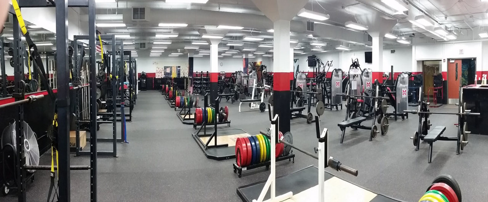 "...and after! Muskego's new weight room has 30 pieces of cardio equipment, 15 circuit-training stations, 6 squat racks, 6 platforms, and 6 benches - and is used by 7 P.E. classes and multiple after-school groups every day. The weight room is organized with, Coach Nitka says, ""surgical precision."""