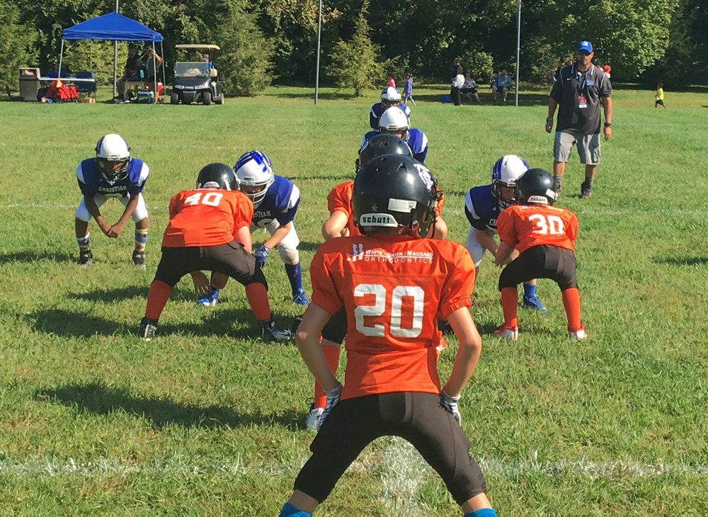 An example of Rookie Tackle football, a small-sided, modified game that bridges the gap between flag football and 11-player tackle.