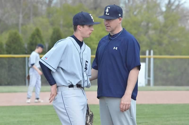Coach Eisenmann discussing quality at-bats with an East Lansing (MI) Junior Varsity player in 2011.
