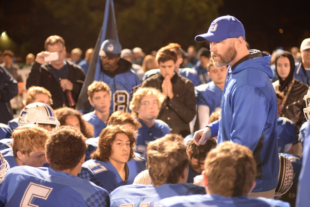Volt coach Tyler Hales talks to his football team at La Jolla Country Day high school in California.