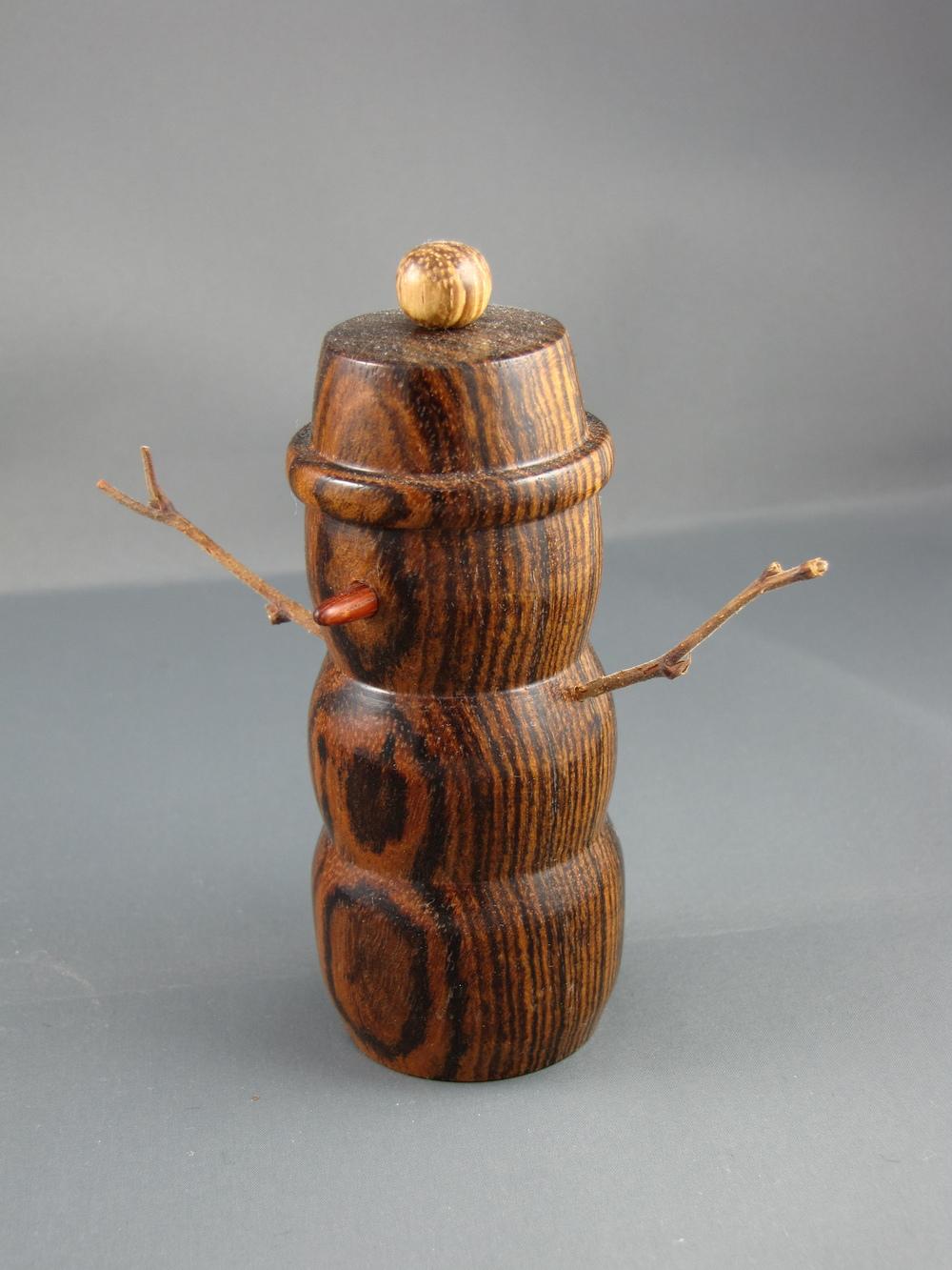 Bocote with a zebrawood pom-pom
