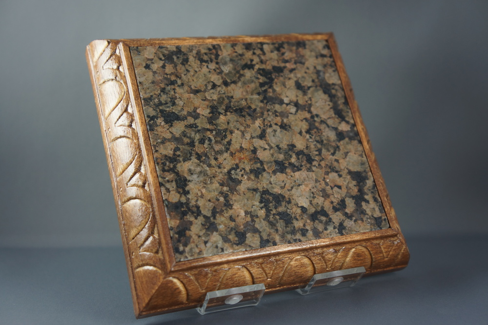 Coaster made from reclaimed granite sample