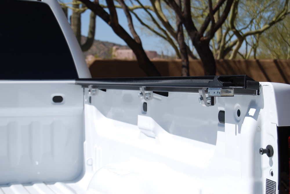 Inside   Rail   Mount        The Inside Rail Mount allows you to use other popular bed accessories that install using your stake hole pocket. Low Profile design adds to your truck sleek appearance.